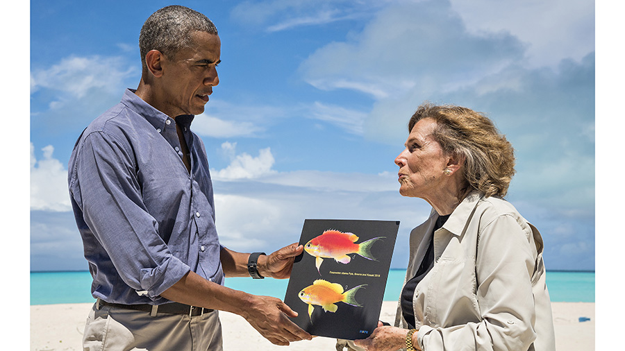 "The President of the United States, Barack Obama arriving on Midway Atoll Midway on September 1, 2016 to commemorate his use of the Antiquities Act to expand the boundaries of  the Papahānaumokuākea Marine National Monument.   Dr. Sylvia Earle gives President Barack Obama a photograph of Tosanoides obama on Midway Atoll, from the film ""Sea of Hope: America's Underwater Treasures"" premiering on National Geographic Channel on January 15, 2017."